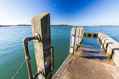 Small Jetty in natural harbour. Stock Image