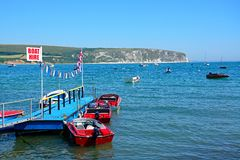 Small jetty at Swanage. Boats moored at a small jetty with cliffs to the rear, Swanage, Dorset, England, UK, Western Europe stock photography