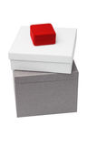 Small jewelry box sitting on giftboxes Stock Photo