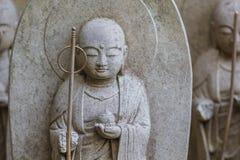 Small Jizo Statues at Hase-dera Temple in Kamakura Stock Photo