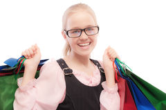 Small joyful girl with purchases Royalty Free Stock Photography