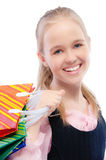 Small joyful girl with purchases Royalty Free Stock Image