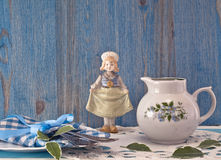 Small jug and antique doll Stock Photo