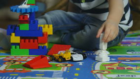 Small Kid Boy Playing a Plastic Toy stock footage
