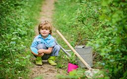 Small kid gardener planting a flower. earth day. Eco life. summer activity. happy child farmer use garden shovel, spring. Human and nature. farming and stock image