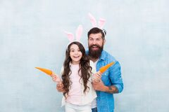 Free Small Kid Girl And Dad In Rabbit Costume. Healthy Food. Happy Family Wear Bunny Ears. Easter Fun And Happiness. Father Royalty Free Stock Photography - 173656047