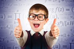 Small kid in glasses on the formulas background Royalty Free Stock Photos
