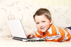 Small kid with laptop Stock Photos