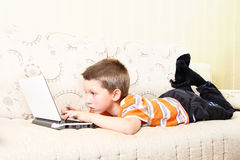 Small kid with laptop Stock Images