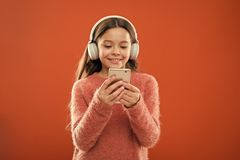 Small kid listen ebook, education. small girl child in headphones. Childhood happiness. Mp3 player. Listen to music royalty free stock image