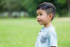 Small kid looking up. Asian young little boy at outdoor stock images
