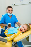Small kid, patient visiting specialist in dental clinic Stock Image