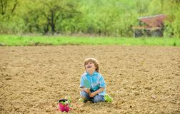 Small kid planting a flower. earth day. new life. summer farm. happy child gardener. botanic worker. Spring season. Ecology and environment. farming and royalty free stock photos