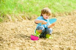Small kid planting a flower. earth day. soils and fertilizers. summer farm. happy child gardener. Flowers presentation. Ecology and environmental protection royalty free stock photos