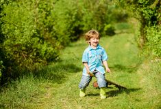 Small kid play with shovel. ecology and environmental protection. earth day. farming equipment. summer fun. happy child. Gardener. spring country side village royalty free stock photo