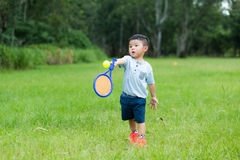 Small kid play with tennis. Asian young little boy at outdoor royalty free stock photos