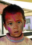 A small kid playing Holi Stock Photography
