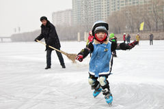 Small kid practicing skating. A small kid was practicing skating on a snowing day, Jinzhou, northeast China Stock Photos