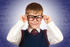 Small kid prodigy on the formulas background Royalty Free Stock Photos