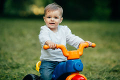Small kid ride a bicycle Stock Photo