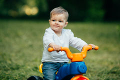 Small kid ride a bicycle Stock Image