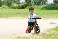 Small kid riding a bike Stock Images