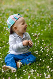 Kid in grass Stock Image