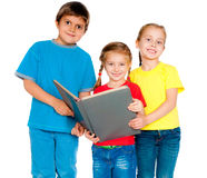 Small kids with a book. Against white Stock Image