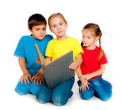 Small kids with a book. Against white Stock Photo