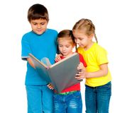Small kids with a book. Against white Stock Photography