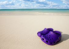 Small kids boots on the beach sand Royalty Free Stock Photos