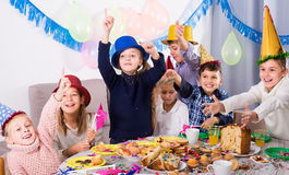 Small kids having a good time at a birthday party Stock Photos