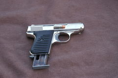 Small killer. 22 pistol smaller the the palm of your hand easy to conceal royalty free stock photos