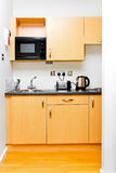 Small kitchen. Small practical kitchen in a studio apartment royalty free stock photography