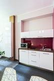 Small kitchen area. In the apartment in city centre Royalty Free Stock Photography