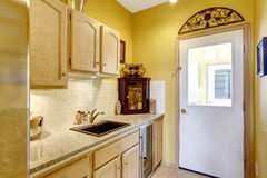Small kitchen area with moden cabinets Royalty Free Stock Image