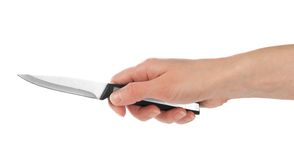 Small kitchen knife in the female hand Royalty Free Stock Photo