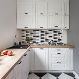 Small kitchen with white furniture. Small kitchen with classic white furniture and modern floor tiles royalty free stock photography