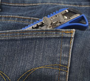 Small knife or cutter in jean's pocket Stock Image