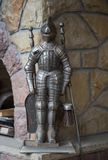 Small knight statue for fireplace cliening. Small silver knight statue for fireplace or chimney cliening, that is holding brush and shovel. It is 20 sm High made royalty free stock images