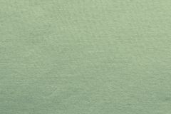 Small knitted texture fabric of green color Stock Photo