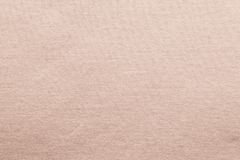 Small knitted texture fabric of pale pink color Royalty Free Stock Photo