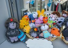 Small knitted toys on the counter of a souvenir shop stock images