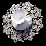 Small lacy doily with  cup Royalty Free Stock Photography