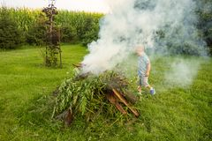 A young boy building a bonfire Stock Photos