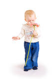 Small lady and a flower Royalty Free Stock Image