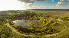Small lake, aerial view. Fairy Lake. Flight over the lake in autumn. small lake, aerial view. view to the west stock video footage