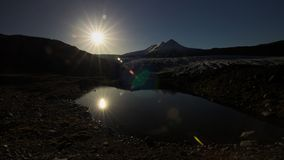 Afternoon sun above the glacier and pond. stock photo