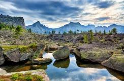 Small lake among glacial moraines. In high mountainous terrain. Ergaki Ridge. Western Sayan. Siberia. Russia royalty free stock photography