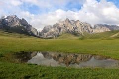 Small lake. In the mountains near Kel-Suu lake, Naryn region, Kyrgyzstan Stock Photos